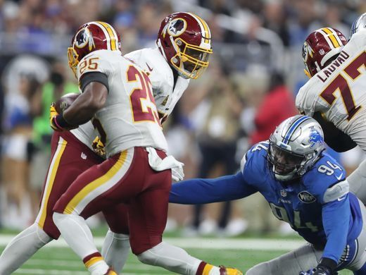 Redskins vs. Lions;   -   October 23, 2016  -  20-17, Lions  -     Lions defensive end Ezekiel 'Ziggy' Ansah tries to tackle the Washington Redskins' Chris Thompson during the second half Sunday, Oct. 23, 2016 at Ford Field in Detroit.  Kirthmon F. Dozier, DFP