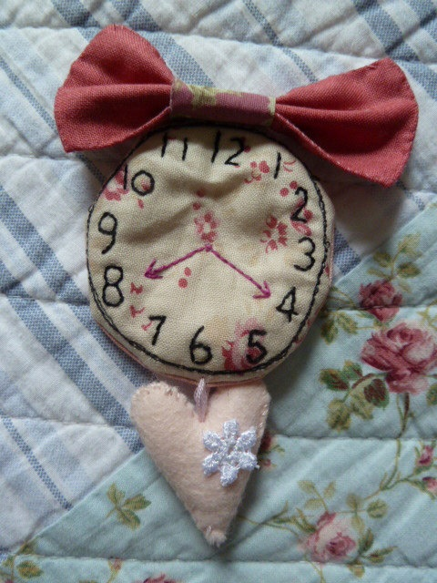 Hand stitched fabric pocket watch brooch by pixie kaye