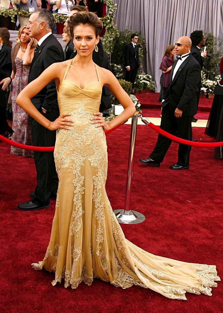 Best Oscar dresses:Jessica Alba looked quite sexy in the tight fitted golden sequinned Versace gown