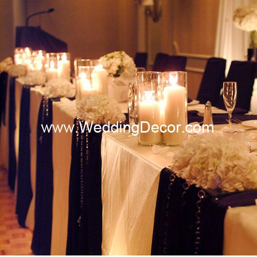 Wedding Decor  Head Table - ivory linens, black runners, hanging crystals, hydrangea, rose petals and candles