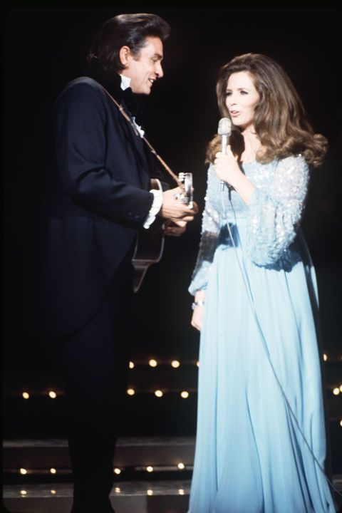 """June Carter was born into a musical family, performing with the Carter Family as early as age 10. She met singer Johnny Cash in 1950 backstage at the Grand Ole Opry, their first duet came in 1964 with """"It Ain't Me Babe."""" The two performed together for years before Cash proposed in front of a live audience in 1968."""