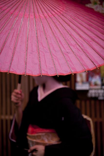 Katsuru under umbrella, Erikae (debut as Geisha)