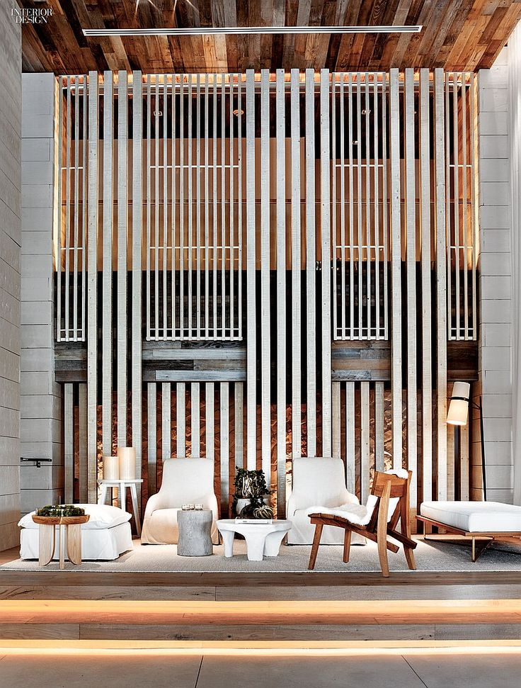 1 Hotel's Miami Beach Debut by Meyer Davis Studio | Antonio Citterio's armchairs back up to the lobby's screen of reclaimed and distressed spruce.