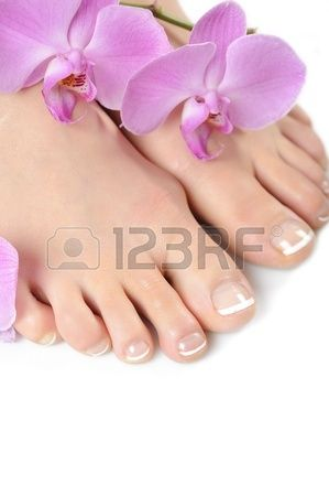 Beautiful feet with perfect spa french nail pedicure isolated Stock fotó