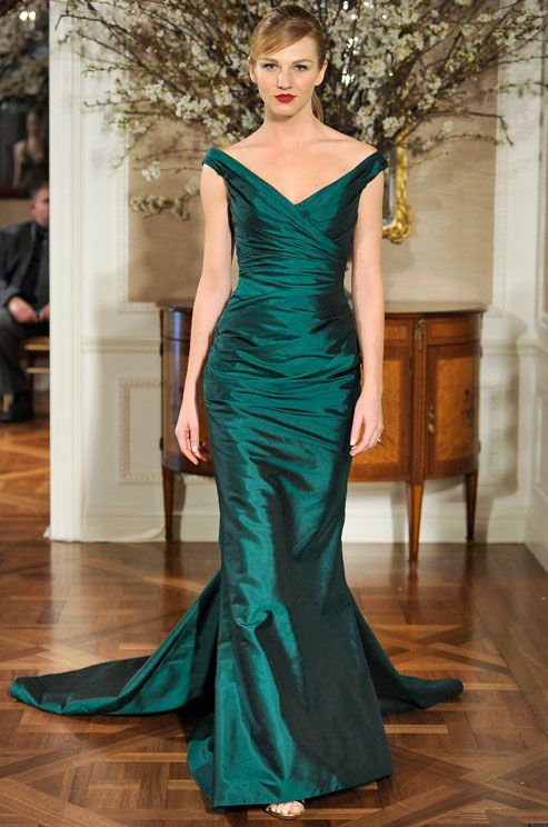 An off-the-shoulder neckline is show-stopping in emerald satin by Romona Keveza Couture.