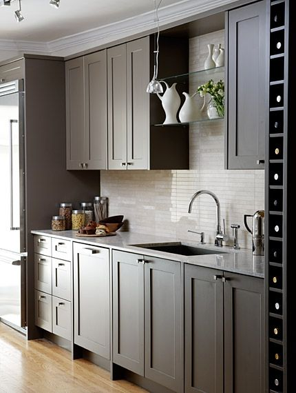 The glossy backsplash with dark muted gray cabinets, and the wine rack...I see this working great in a small space.