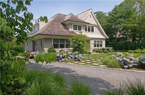 The tumbling exuberance of these hydrangeas makes the perfect complement to a farmhouse or country style. Landscape by Barry Block Design & Contracting. For more country design ideas visit http://www.landscapingnetwork.com/garden-styles/country/