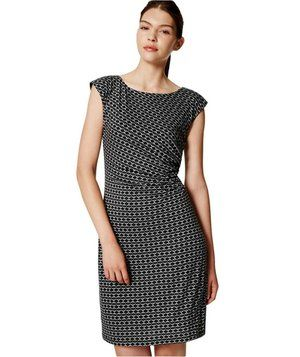 This sleek sheath is fitted in all the right places (and skims over all the others), thanks to subtle asymmetric shirring at the waist.