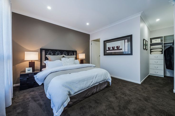 #Bedroom #interior #design #inspiration from #Ausbuild's Bellfield display home. This #bedroom features soft #espresso carpet combined with a soft grey feature wall and deep wooden #furnishings.