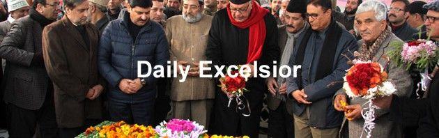 National Conference patron Farooq Abdullah offering Fateh Khwani on the grave of his father and party founder Sheikh Muhammad Abdullah during a function to commemorate his birth anniversary at Hazratbal on Monday.Excelsior/Shakeel