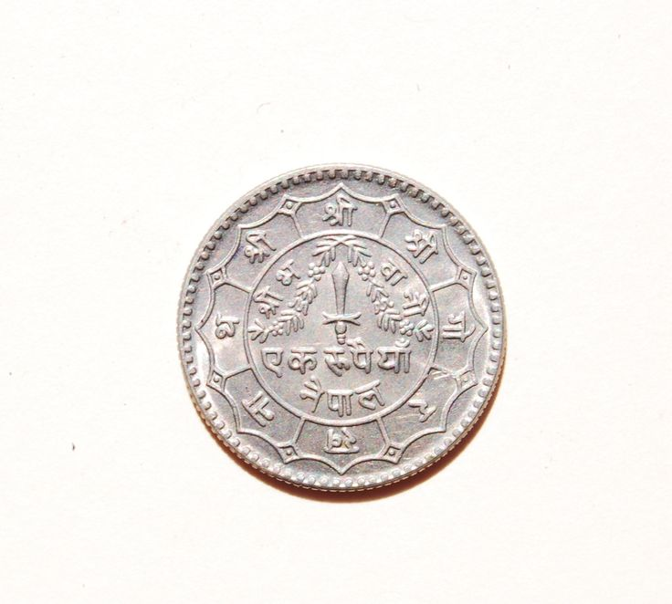 6b.   Reverse side of a Tibetan 10 Srang cash coin, unknown date.
