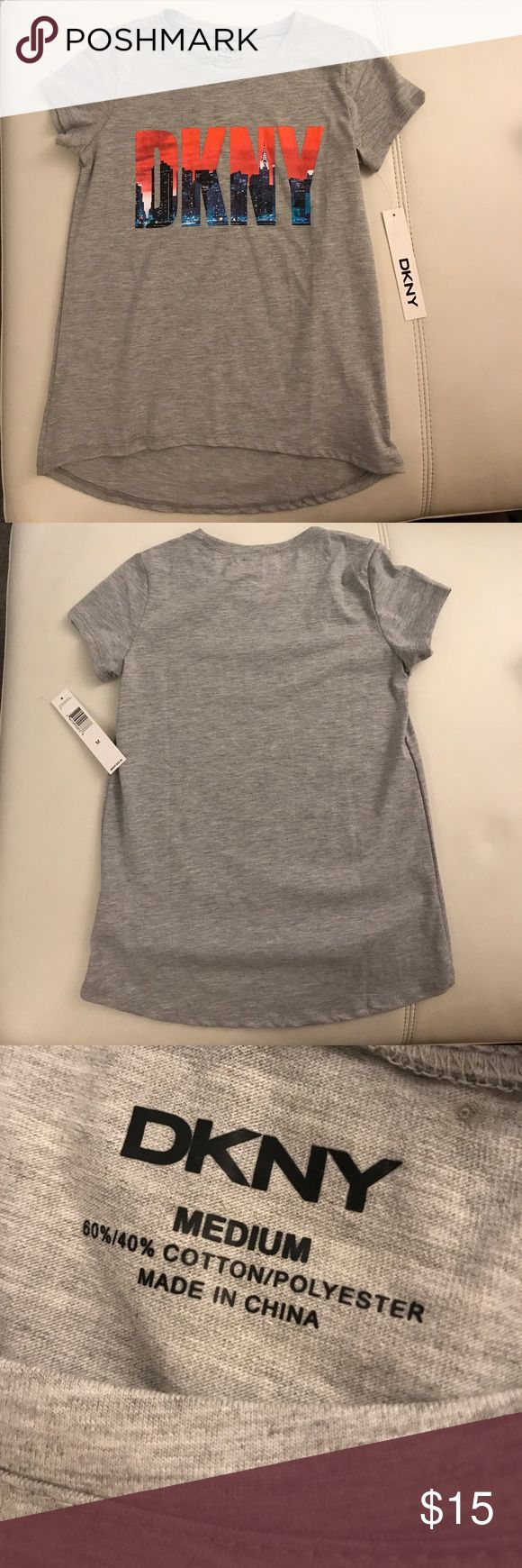 """DKNY Girls' Gray Printed Logo T-shirt Medium Authentic DKNY for Girls in Medium. I'm no expert when it comes to kids' sizing but on the tag it says """"Girls 7-16 Top"""". New with tags still attached. DKNY Shirts & Tops Tees - Long Sleeve"""