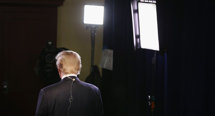 Republican presidential candidate Donald Trump gives an interview in the spin room after a debate in Milwaukee, Wisconsin, November 10, 2015.