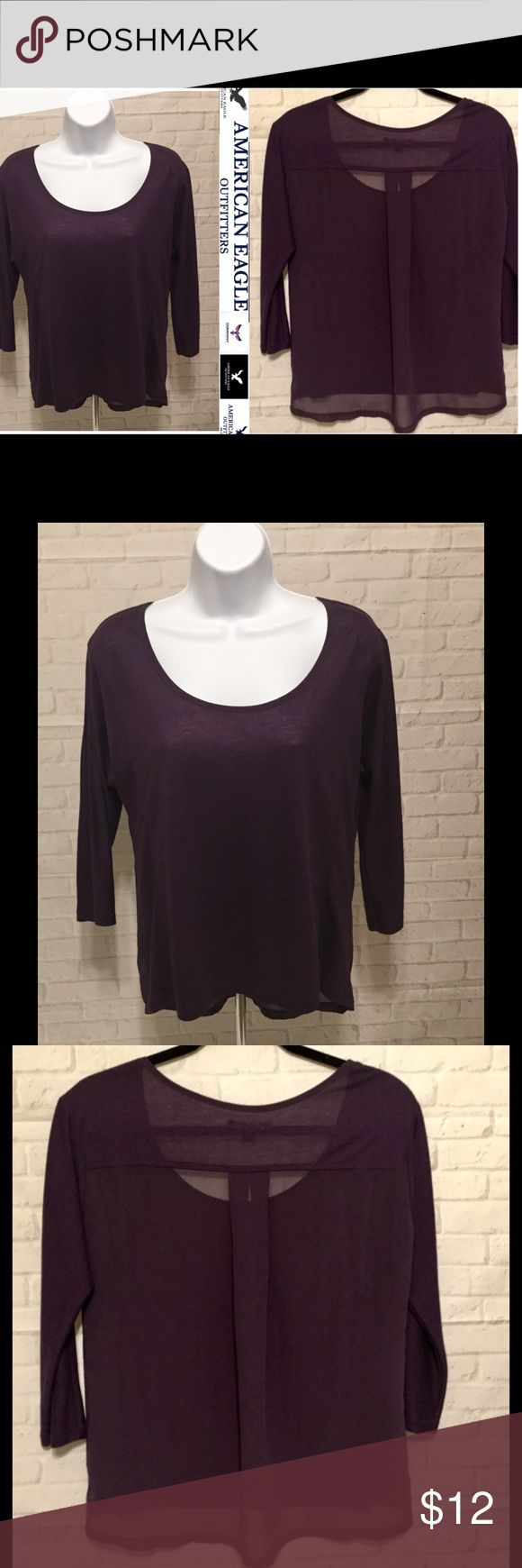 """American Eagle top women's small S/P shear back This is a very stylish high low American Eagle top with an elegant shear back.  This Top is in EXCELLENT CONDITION and comes from a smoke free home.   Sooooo many options wear it casual with leggings,  wear it to work❤❤❤👍👍. The front length measures approx. 22"""" the back length measures approx. 25"""".  Buy with confidence I am a top rated seller and fast shipper.  Don't forget to bundle and save.  Thank you. American Eagle Outfitters Tops…"""