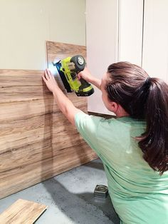 Laminate Flooring Backsplash, that looks like wood! The backsplash is REALLY easy to clean up since it is wipeable which is MUST when it comes to all backsplashes.  And the fact that this is affordable, removable, and looks amazing  its like the triple