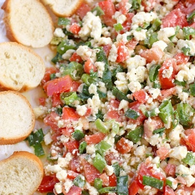 Feta Dip. Olive oil, tomatoes, onions, feta cheese! Served with baguette. Always a hit!