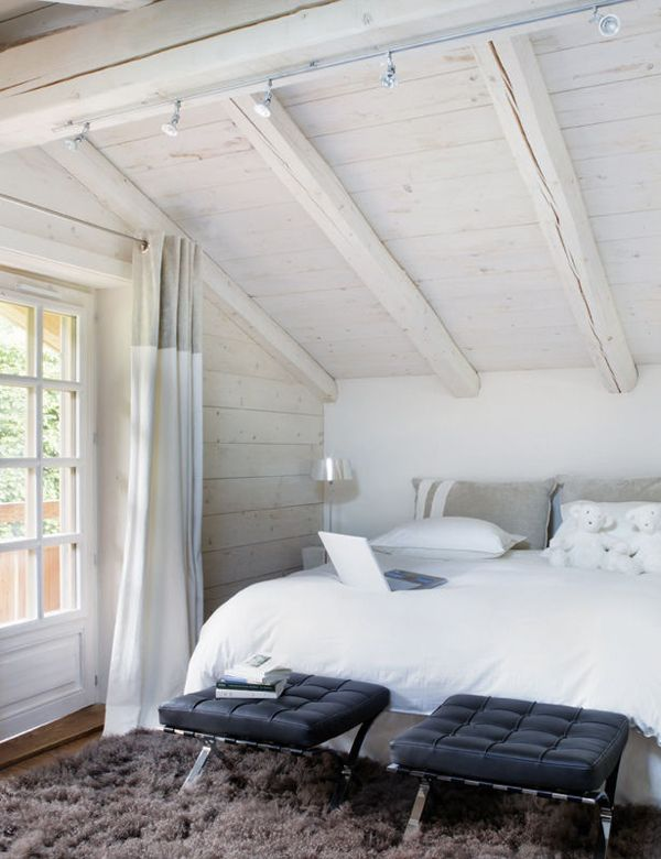 Love the fluffy rug and stools at the end of the bed. Come in handy for changing clothes/shoes.