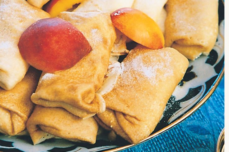 Serve these traditional Russian crepes with sweet ricotta filling as a special dessert any day of the week.