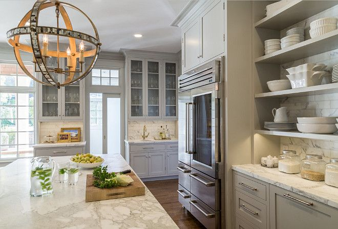 The Ultimate Gray Kitchen Design IdeasThe island and perimeter countertops in this gray kitchen is Calacatta d'Oro marble. Calacatta d'Oro is a white and grey stone with bits of gold and rust colors mixed in.