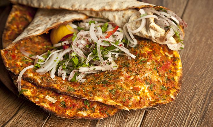 Lahmacun is also called Turkish pizza as it is flat, topped with minced meat, onions and pepper- but the catch here is to eat it by wrapping it after squezing lemon and adding parsley!
