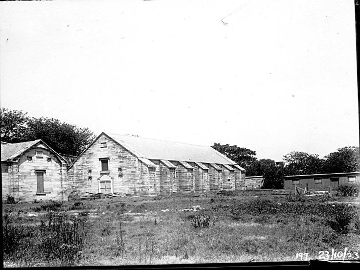 Goat Island gunpowder magazine, built to the order of Governor Bourke in 1836. The smaller building on the left hand side was built as a Guard House in the same year. Both buildings were still in good condition when the island was transferred from the control of the Maritime Services Board to National Parks and Wildlife Service in May 1994. Photograph taken October 23, 1923.