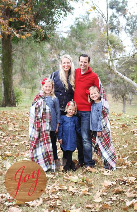 simple but cute family christmas card everyone dress in denim red and black red plaid christmas blanket to wrap around