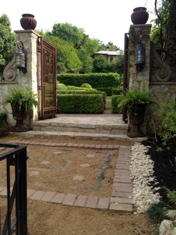 Freshly Groomed Gravel Rug And Mid Gardens Entry Gates
