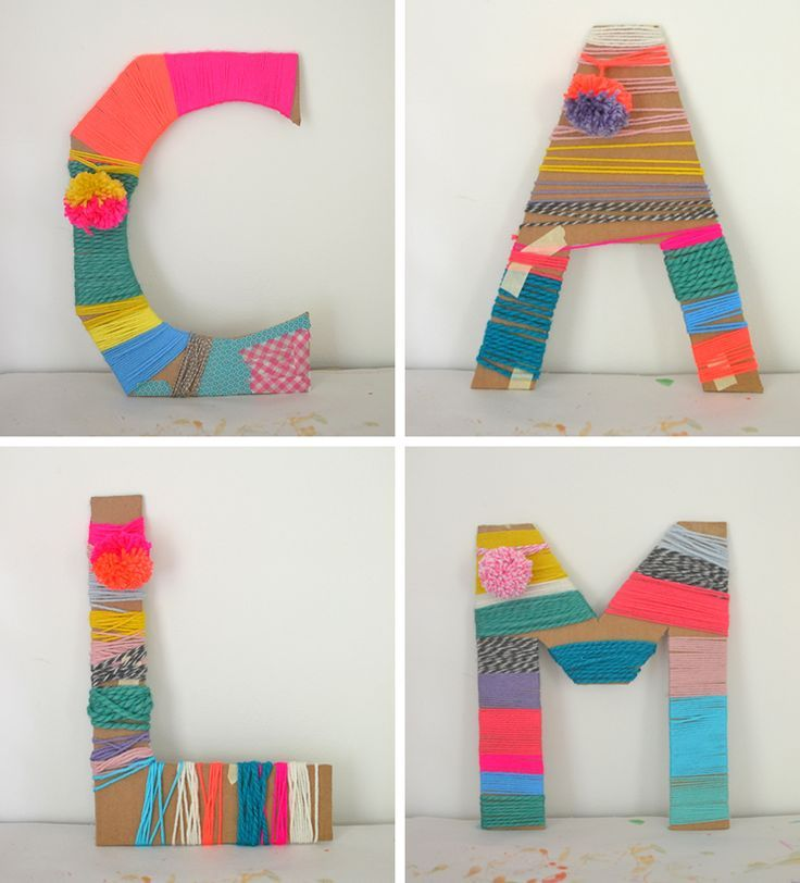 Cardboard letters wrapped with yarn made by kids.