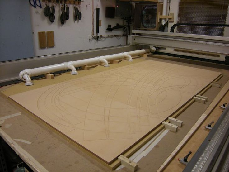 """CNC Vacuum Hold Down by B.H. Davis -- Homemade hold down system for a CNC router. Vacuum is supplied by four vacuum motors plumbed as a single unit. Hold down panels were constructed from 24""""x48"""" sheets of 3/4"""" MDF. http://www.homemadetools.net/homemade-cnc-vacuum-hold-down"""