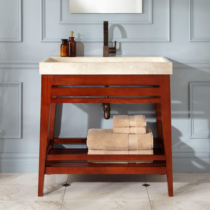 white porcelain trough bathroom sink with wooden base as console vanity added towel storage also small square wall mirror in vintage bathroom ideas