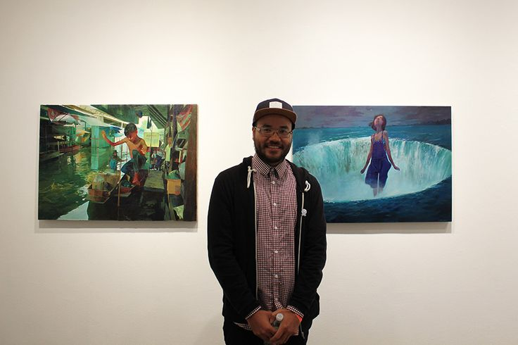 Andrew Hem in front of his works, 'Market Street' and 'Whirlpool'