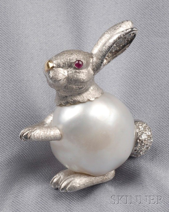 18kt White Gold, Baroque Pearl, and Diamond Rabbit Brooch, E. Wolfe & Co., London, with cabochon ruby eyes, and diamond melee ears and cotton tail, lg. 1 1/4 in., English hallmarks and maker's mark.