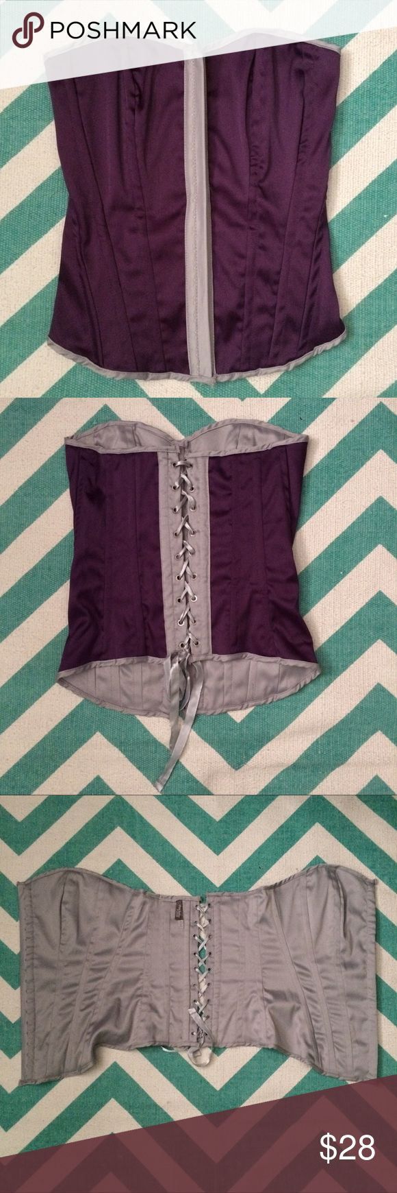 """Purple/Gray Satin-y Corset Dress up your wardrobe with a bit of boudoir style with this lovely purple corset with silver lining. EUC; size Small; worn only once for Steampunk event. When tied and laid flat it measures 12"""" at bust and 11"""" at smallest part of waist. Made of polyester/spandex blend. I am a 33"""", small B cup, petite with semi-athletic build and this fit wonderfully. Bundle or grab this up today! Charlotte Russe Intimates & Sleepwear Shapewear"""