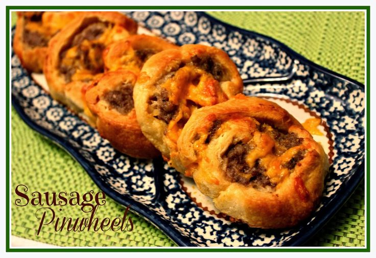 Sausage Pinwheels.  Only three ingredients: 1 can refrigerated crescent rolls 1 (1lb.) roll of breakfast sausage 1 cup shredded cheddar cheese