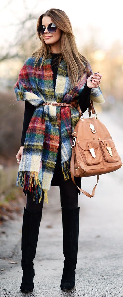 Not sure how to style a blanket scarf? Try wearing it like a poncho and belting it at the waist. It not only adds an extra layer of warmth but it flatters your figure too.