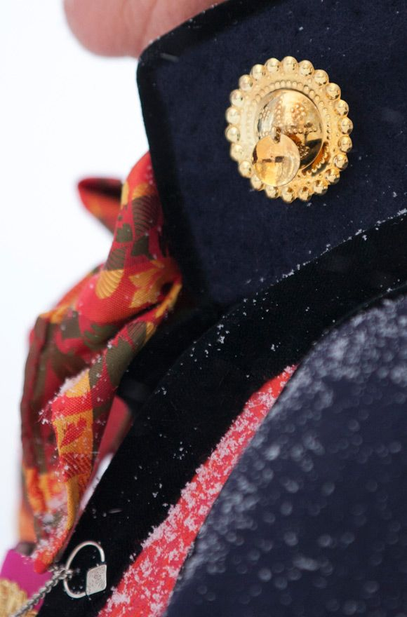 The collar of the jacket shows the influence from the Empire epoch at the beginning of the 19th century. The large gilded buttons with hanging leaves shows that the jacket will be worn on festive occasions. The reconstructed bunad from Sogn illustrates how women dressed in the inner and central parts of Sogn in the first part of the 19th century. The original was painted by the artist Johannes Flintoe in 1822 and there are also written testaments on how women would dress in the area.