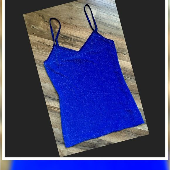 Express Blue Metallic Cami Top Express Blue Metallic Cami Top W/ adjustable straps Size-XS  This dies  Not have a built in bra... 92% Nylon/4% Metallic/4% Spandex Express Tops Camisoles