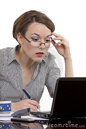 Young business woman wearing glasses having a hard time deciding about the right info on her notebook.