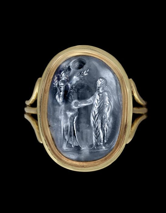 A Roman sapphire intaglio -  Circa 2nd Century A.D.  Though they were keenly collected in antiquity, most carved gems originally functioned as seals, often mounted in a ring; intaglio designs register most clearly when viewed by the recipient of a letter as an impression in hardened wax. A finely carved seal was practical, as it made forgery more difficult - the distinctive personal signature did not really exist in antiquity.