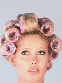 I'm always amazed when women have this caught look when in rollers, we wore them everywhere almost, but then there was the boyfriend factor, so excuse me, maybe her boyfriend just walked in