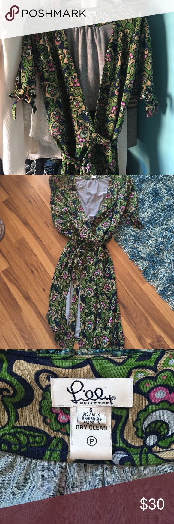 Lilly Pulitzer petite small wrap dress Gorgeous green, navy, pink & light brown wrap dress. The wrap style is so flattering & forgiving. It is in EUC. Short sleeves with little bows on the sleeves. Petite small, Lilly. Lilly Pulitzer Dresses Midi