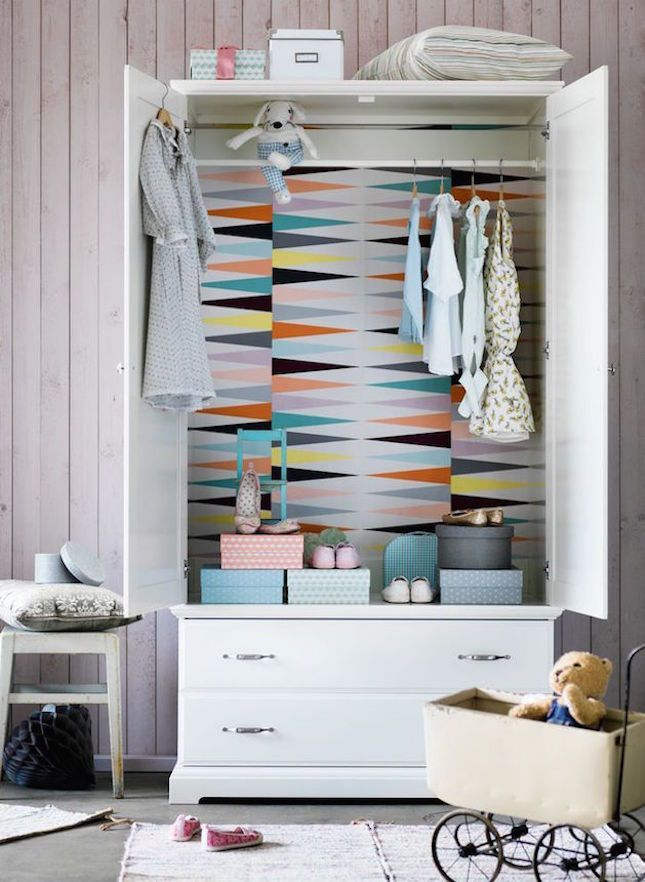 Add a whimsical wardrobe to your kid's bedroom.