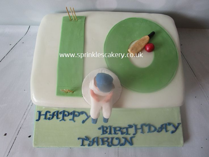 A fondant covered cricket themed cake with a handmade edible topper.