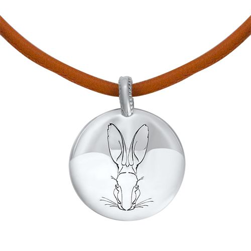 A modern interpretation of an ancient votive. This unisex series is solid, tactile, and engraved with the Hargreaves hare motif. Fairmined Silver pendant on ecological vegetable dyed leather #fairmined #fairminedsilver #fwstockholm #aw17