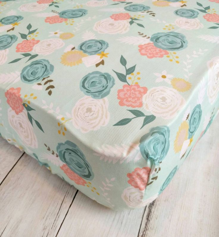 Pink and teal florals Sheets don't have to be boring! Skip the plain white sheet and dress up your baby girl's crib with this beautiful floral crib sheet. The background is mint green with watercolor flowers in light pink, teal, and ivory. I am happy to customize a crib sheet to match any of my quilts as wel