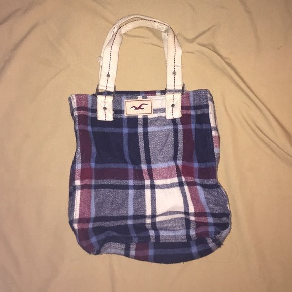 Hollister Tote Bag Used Hollister tote bag for sale. Some signs of wear (pictures included). Plaid material on outside and lined inside. Pretty good condition. Hollister Bags Totes