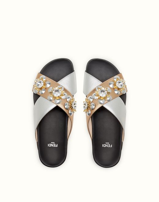 Fendi flat sandals in champagne and silver.