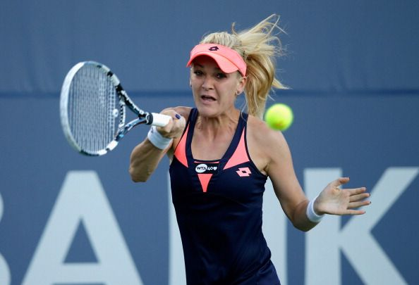 Agnieszka Radwanska of Poland returns a shot to Francesca Schiavone of Italy during their match on Day 3 of the Bank of the West Classic at Stanford University Taube Family Tennis Stadium on July 24, 2013 in Stanford, California