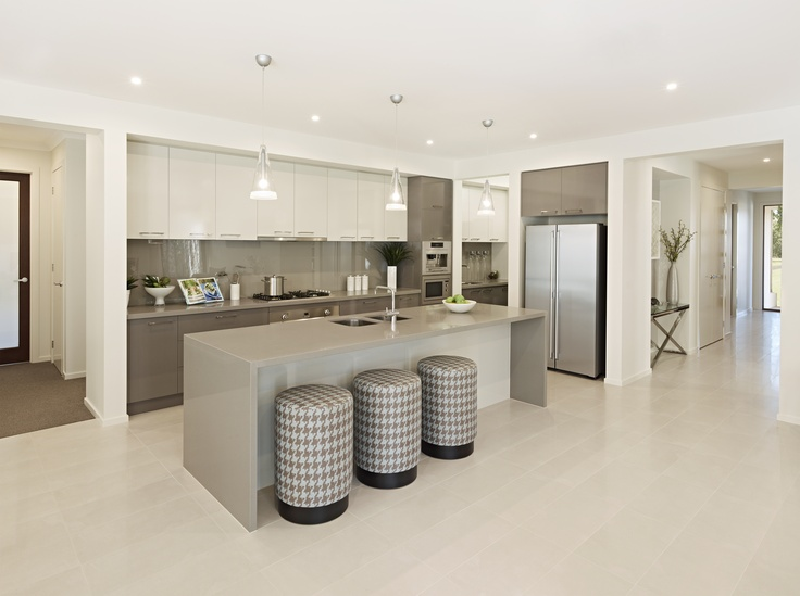 Feature lights over your #islandbench add a touch of #glamour whilst also helping food preparation, like seen in our #Marseille33 design.   Hot tip - cover #bar #stools with a stylish #fabric to compliment your #kitchen decor colours.    http://www.boutiquehomes.com.au/home-design/marseille-33