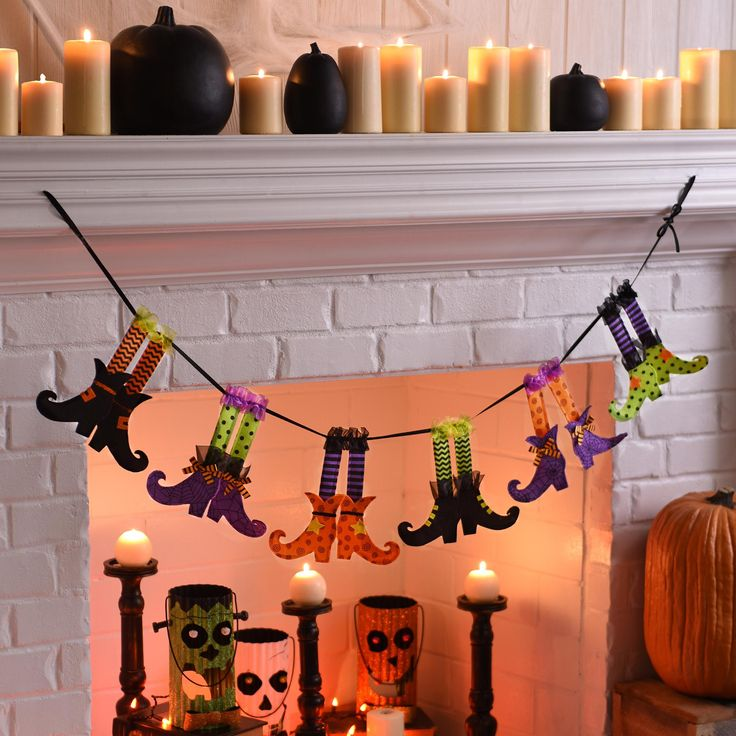 For the month of October, switch out your fall mantle decor for fun Halloween decor! Our Witch Legs Banner is just the right amount of festive for a stylish mantlepiece. The witches' boots and stockings in bright orange, purple and green will be loved by the whole family!